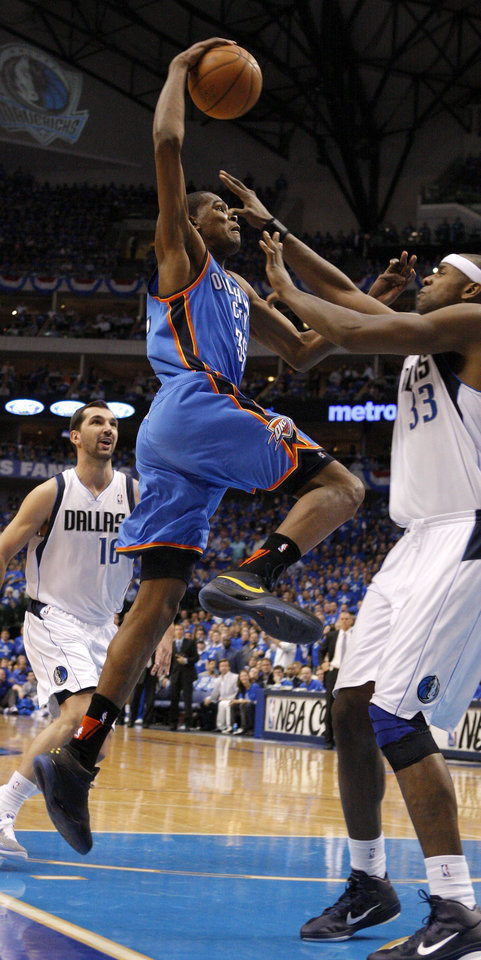 Oklahoma City's Kevin Durant (35) goes between Peja Stojakovic (16), and Brendan Haywood (33) of Dallas  during game 2 of the Western Conference Finals in the NBA basketball playoffs between the Dallas Mavericks and the Oklahoma City Thunder at American Airlines Center in Dallas, Thursday, May 19, 2011. Photo by Bryan Terry, The Oklahoman