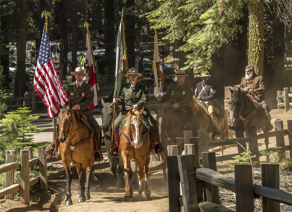 Photo - In this Monday, June 30, 2014, photo provided by Yosemite Conservancy, Yosemite and California State Parks Mounted Patrol open ceremonies marking the 150th Anniversary of the Yosemite Grant Act and groundbreaking for the restoration of the Mariposa Grove of Giant Sequoias. President Abraham Lincoln signed the Yosemite Grant on June 30, 1864, ushering in the national park idea. (AP Photo/Yosemite Conservancy, Al Golub)