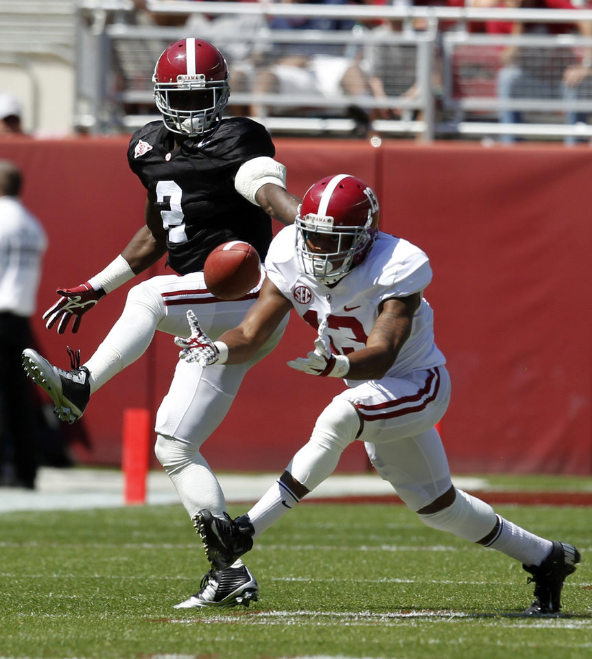 Photo - Wide receiver ArDarius Stewart (13) catches a deflected pass over defensive back Tony Brown (2) during Alabama's A-Day NCAA college football spring game Saturday, April 19, 2014, in Tuscaloosa, Ala. (AP Photo/Butch Dill)