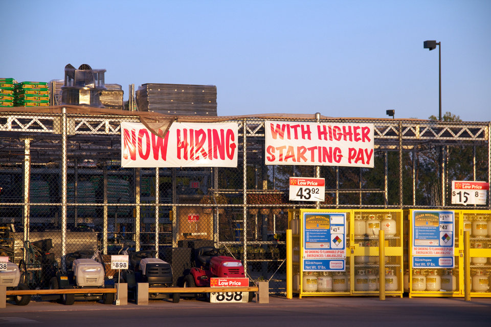 A �Help Wanted� sign is displayed in front of Elk City�s Super Walmart. The booming oil industry has created more than 3,000 jobs over the past seven years, but has made it difficult for other businesses in the area to compete for employees.