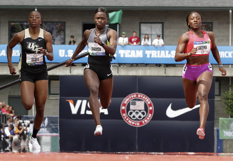 Aurieyall Scott, left, Jeneba Tarmoh, center, and Bianca Knight compete in the women's 200 meter semi-finals at the U.S. Olympic Track and Field Trials Friday, June 29, 2012, in Eugene, Ore. (AP Photo/Eric Gay)