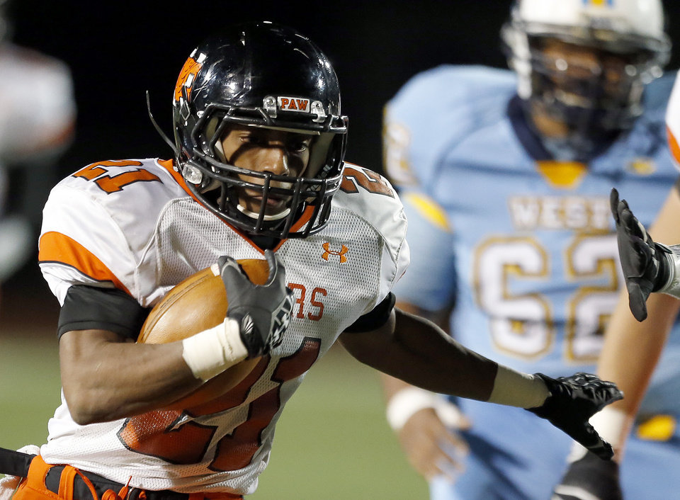 Norman\'s Imond Robinson rushes during the high school football game between Putnam City West and Norman at Putnam City High School, Thursday, Oct. 25, 2012. Photo by Sarah Phipps, The Oklahoman