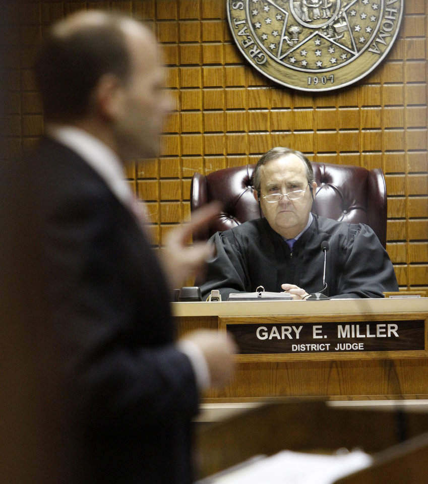 Photo - Judge Gary Miller listens to opening statements by District Attorney Mike Fields in the Canadian County Courthouse in El Reno , Wednesday May 8, 2013. Bryan is accused of killing her husband, Keith Bryan, 52, who was the Nichols Hills fire Chief. Photo By Steve Gooch, The Oklahoman