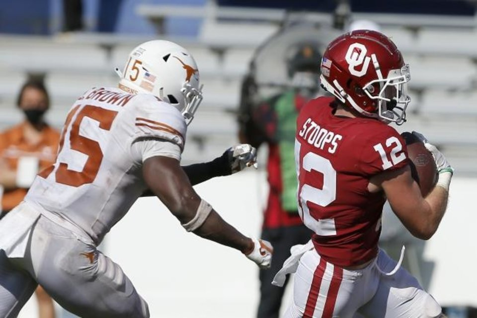 Photo -  Oklahoma's Drake Stoops (12) runs to the end zone past Texas' Chris Brown (15) in the fourth overtime of the Sooners' 53-45 win Oct. 10 at the Cotton Bowl in Dallas. [Bryan Terry/The Oklahoman]