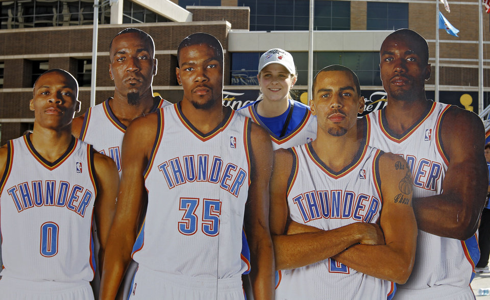 Photo - Sara Wilson poses for a photo with Thunder player cardboard cutouts in Thunder Alley during Game 2 of the NBA Finals between the Oklahoma City Thunder and the Miami Heat at Chesapeake Energy Arena in Oklahoma City, Thursday, June 14, 2012. Photo by Chris Landsberger, The Oklahoman