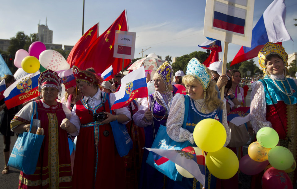 Participants from Russia march during a parade where groups of Christians from various countries show their support for Israel in Jerusalem, Thursday, Oct. 4, 2012. Waving blue and white flags, thousands of Christians from around the world filled the streets of downtown Jerusalem on Thursday in a show of support for Israel that reflected the growing relationship between evangelical Christians and the Jewish state. (AP Photo/Sebastian Scheiner)