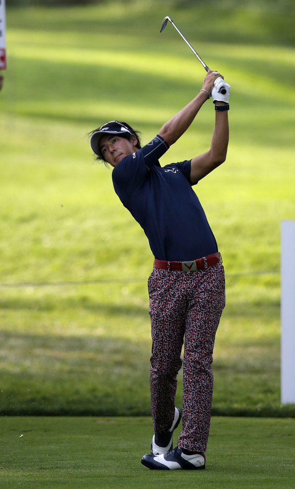 Photo - Ryo Ishikawa, of Japan, watches his tee shot on the 15th hole during the first round of play at The Barclays golf tournament Thursday, Aug. 21, 2014, in Paramus, N.J. (AP Photo/Mel Evans)