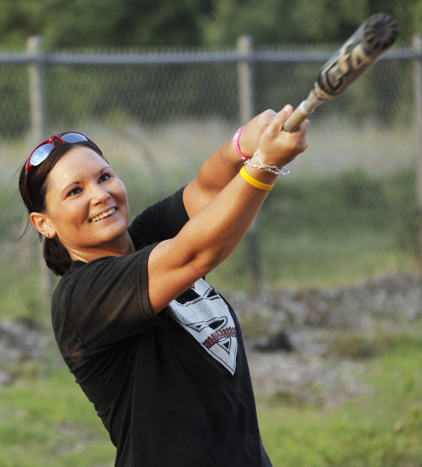 Photo - Coach Mandy Fulton hits balls during a fielding drill at practice for the OKC Strikkers softball team in Oklahoma City, Thursday, May 27, 2010.  Mandy Fulton was a member of OU's national championship softball team in 2000. Photo by Nate Billings, The Oklahoman