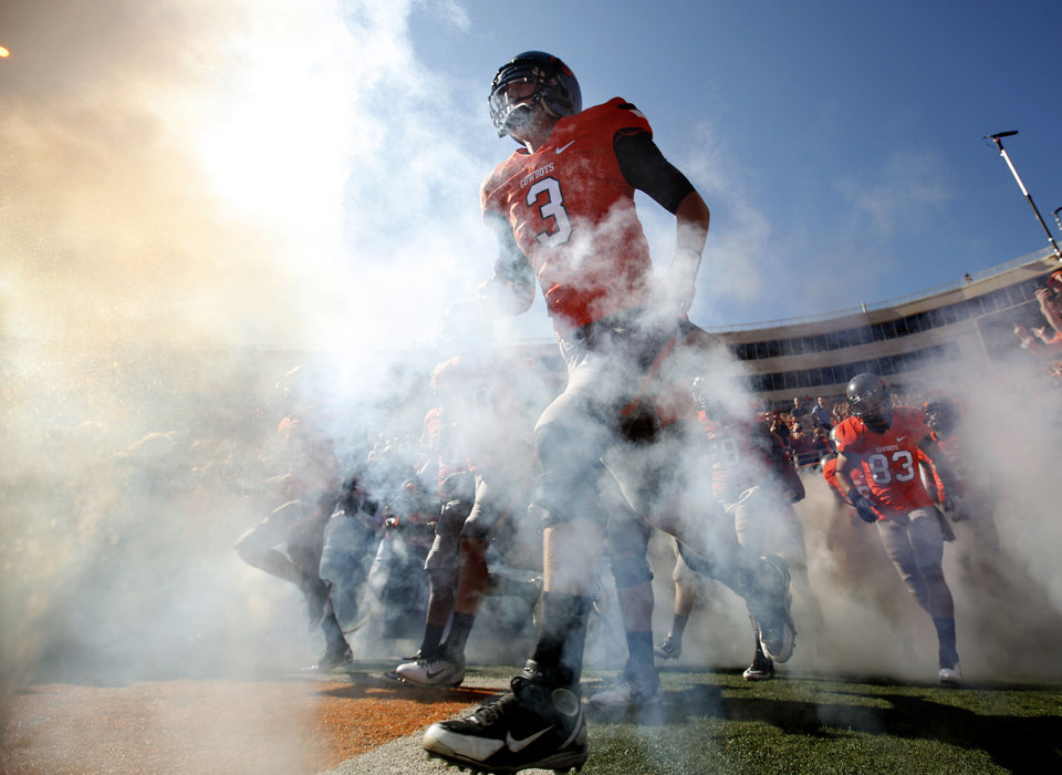Photo - Oklahoma State's Brandon Weeden (3) runs on to the field before a college football game between the Oklahoma State University Cowboys (OSU) and the Baylor University Bears (BU) at Boone Pickens Stadium in Stillwater, Okla., Saturday, Oct. 29, 2011. Photo by Sarah Phipps, The Oklahoman