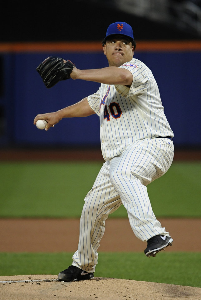 Photo - New York Mets starter Bartolo Colon pitches against the Philadelphia Phillies in the first inning of a baseball game at Citi Field on Saturday, Aug. 30, 2014, in New York. (AP Photo/Kathy Kmonicek)
