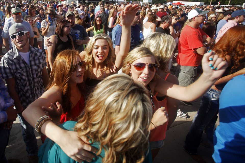 Photo - Music fans dance to the beat as Casey Donahew Band performs at OKC Fest in downtown Oklahoma City on Friday, June 27, 2014. OKC Fest is a new two day country music festival with multiple stages downtown. Photos by KT King/The Oklahoman