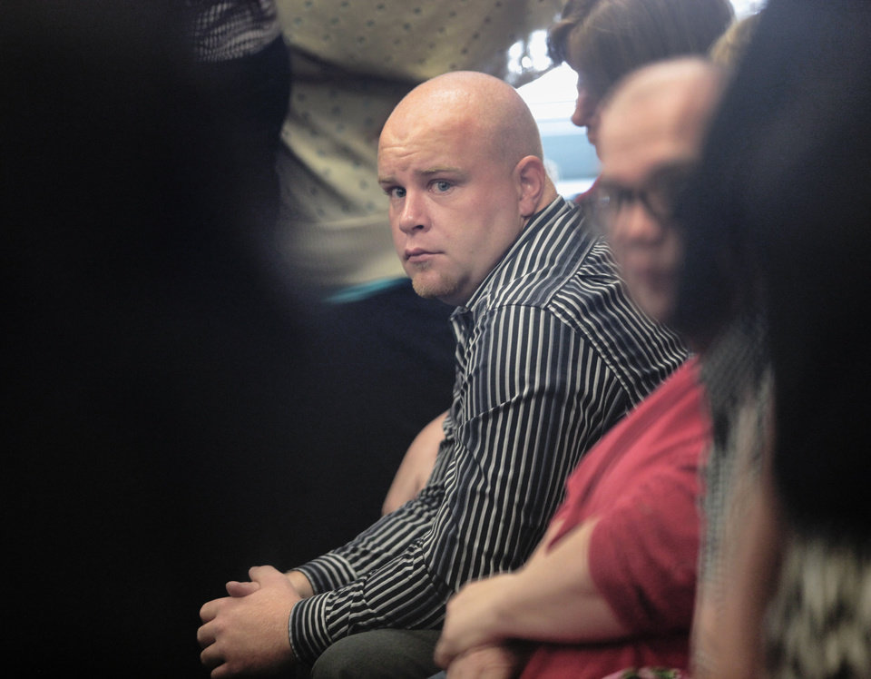 Photo - Justin Adams, man once charged with pregnant wife's death, now facing manslaughter charges in Judge D. Fred Doak's courtroom at the County Courthouse.  David McDaniel - The Oklahoman