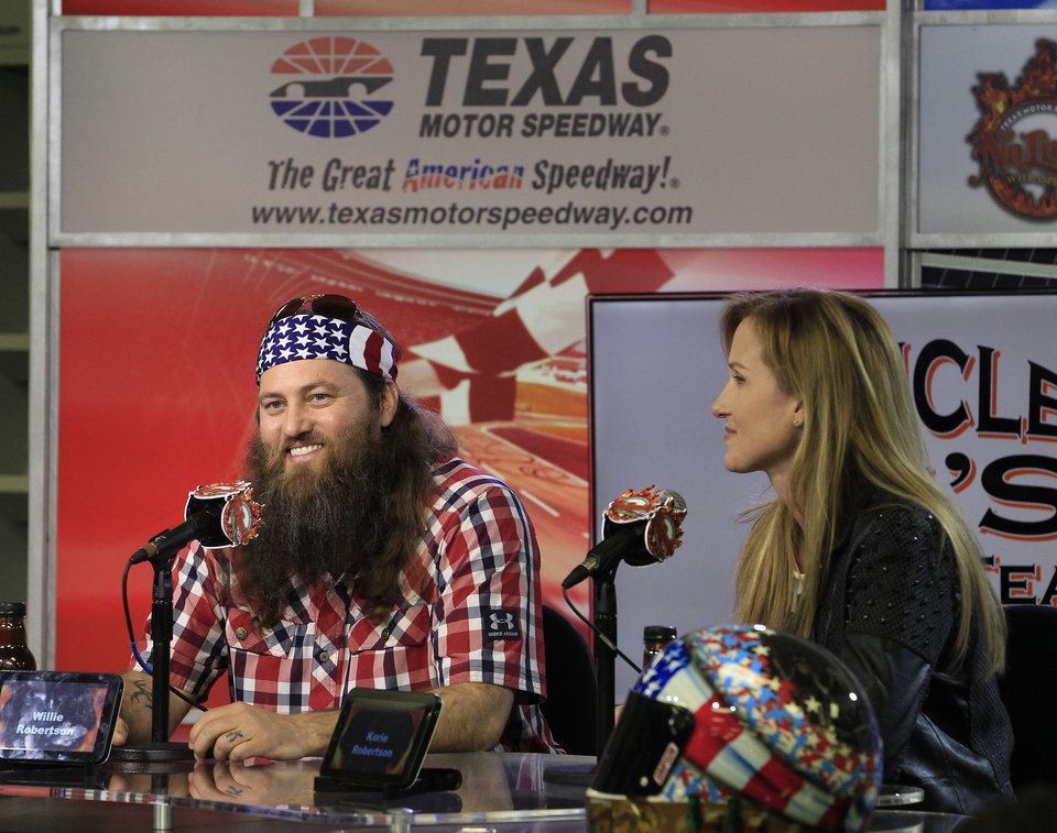 Photo - Duck Dynasty stars Willie and Korie Robertson. Texas Motor Speedway debuted their new Big Hoss TV, a 218 x 94 foot screen over the east grandstands of the racetrack, Wednesday, March 19, 2014. The first show to be seen on the screen by the public is Wednesday's episode of