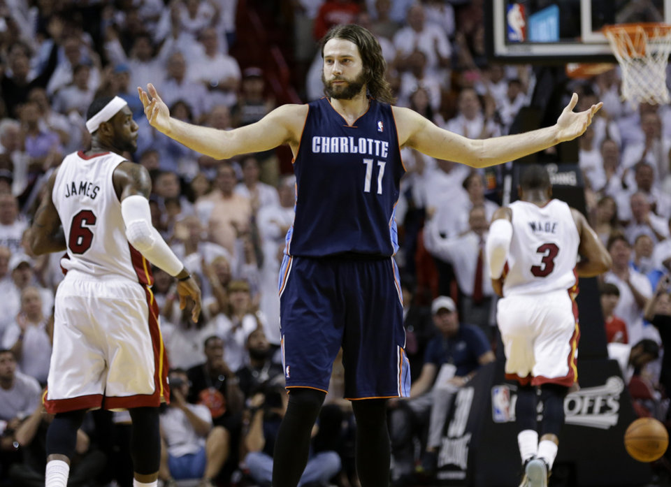 Photo - Charlotte Bobcats' Josh McRoberts (11) reacts after being called for a foul during the second half in Game 2 of an opening-round NBA basketball playoff series against the Miami Heat, Wednesday, April 23, 2014, in Miami. The Heat defeated the Bobcats 101-97. (AP Photo/Lynne Sladky)