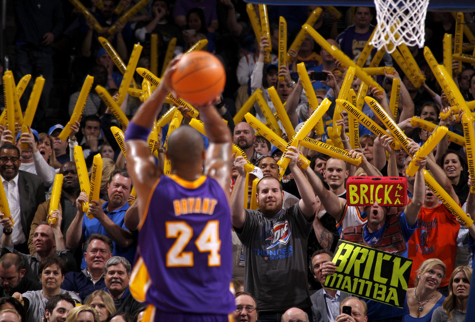 Photo - Fans scream as Los Angeles' Kobe Bryant (24) shoots a free throw during an NBA basketball game between the Oklahoma City Thunder and the Los Angeles Lakers at Chesapeake Energy Arena in Oklahoma City, Thursday, Feb. 23, 2012.  Oklahoma City won 100-85. Photo by Bryan Terry, The Oklahoman