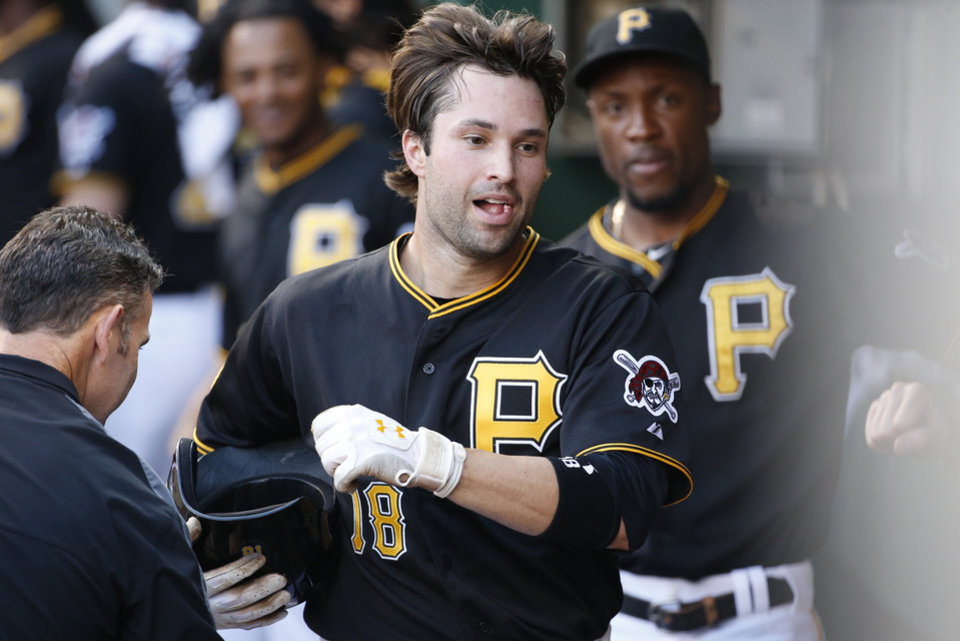 Photo - Pittsburgh Pirates' Neil Walker (18) celebrates in the dugout after hitting a solo home run off Los Angeles Dodgers starting pitcher Josh Beckett during the second inning of a baseball game in Pittsburgh Tuesday, July 22, 2014. (AP Photo)
