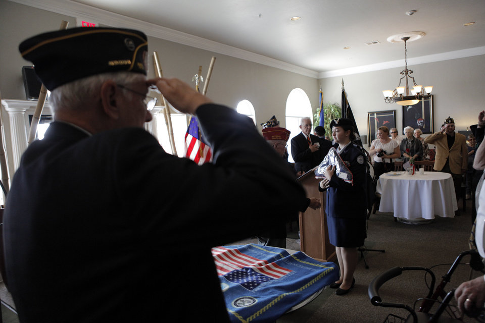 The presentation of the colors by Edmond North High School JROTC during an American Legion veterans ceremony at the Edmond Mansions retirement village in Edmond.  Photo by Garett Fisbeck, The Oklahoman <strong>GARETT FISBECK - GARETT FISBECK</strong>