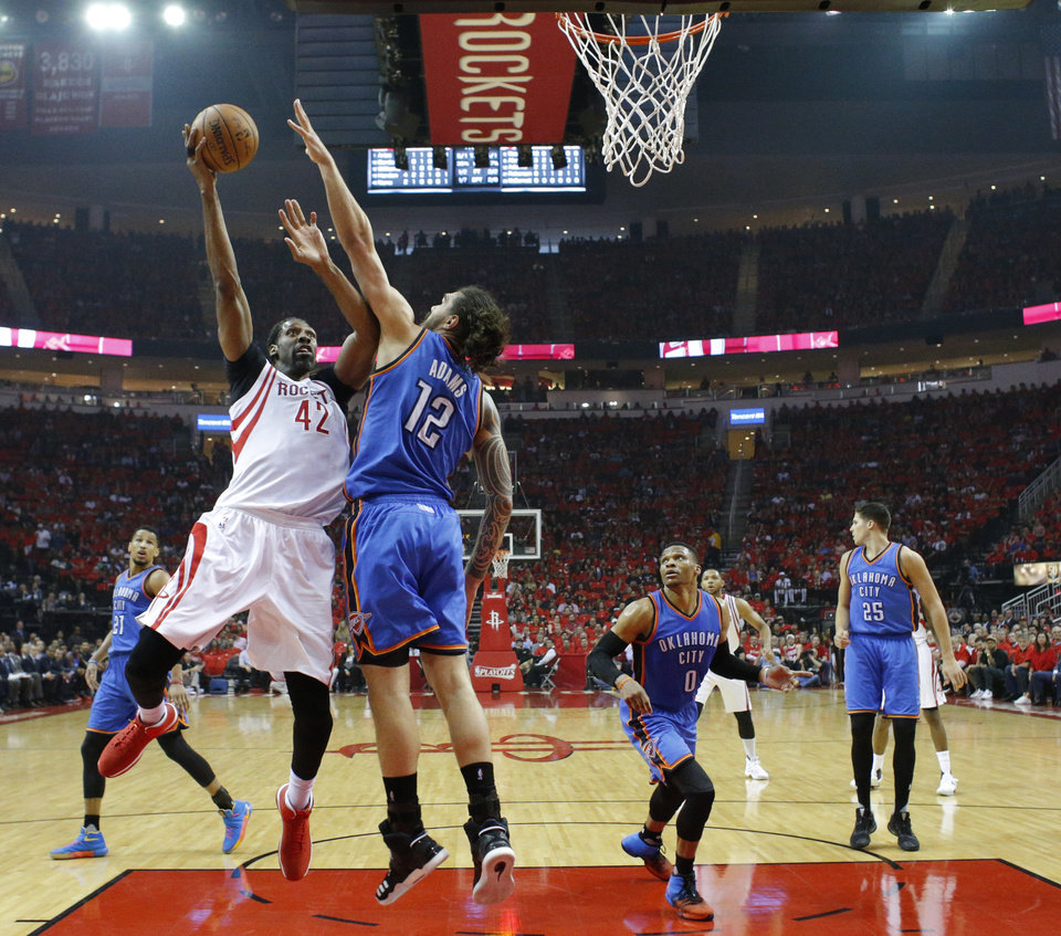 Photo - Oklahoma City's Steven Adams (12) defends against Houston's Nene (42) during Game 5 in the first round of the NBA playoffs between the Oklahoma City Thunder and the Houston Rockets in Houston, Texas,  Tuesday, April 25, 2017.  Houston won 105-99. Photo by Sarah Phipps, The Oklahoman