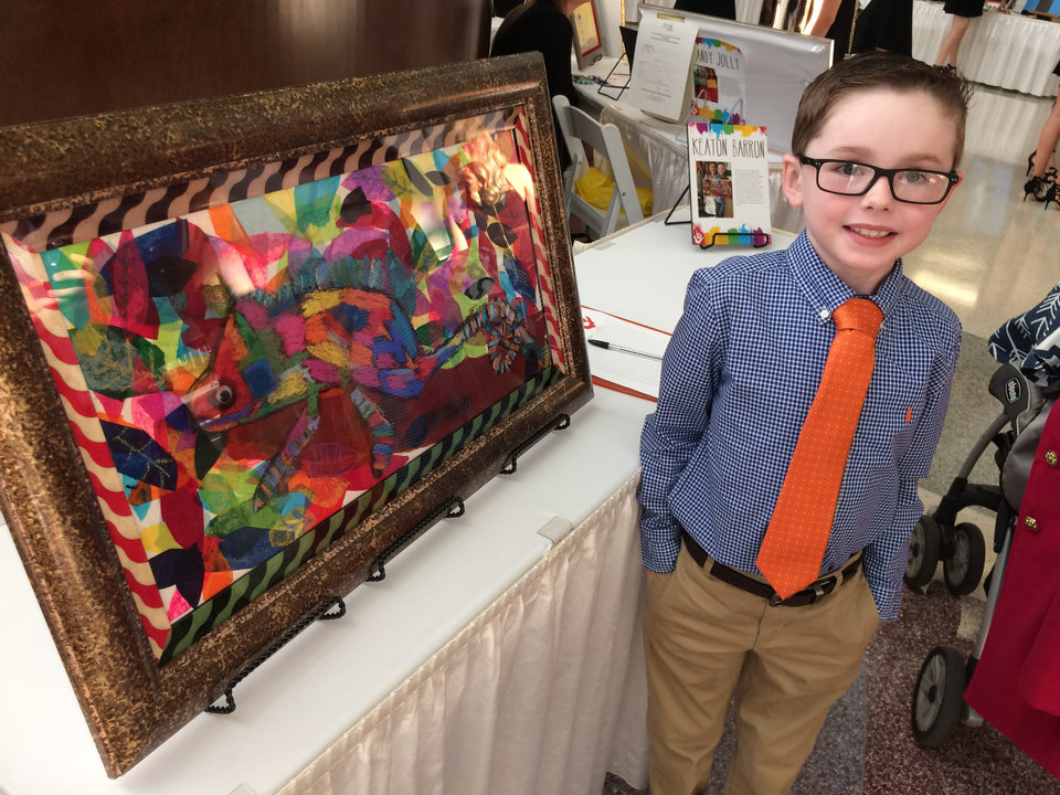 Photo -  Keaton Barron, then 6, shows a painting he made of a chameleon at the Art with a Heart auction in 2017. Young artists like Keaton who have been treated for cancer exhibit their artwork to raise money for the Oklahoma Children's Cancer Association. [Photo provided by Holly Barron]
