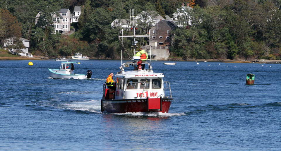 Photo -   In this Saturday, Oct. 13, 2012 photo, a Portsmouth fire boat joins the search of the Piscataqua River in Portsmouth, N.H., for the body of missing University of New Hampshire student Elizabeth