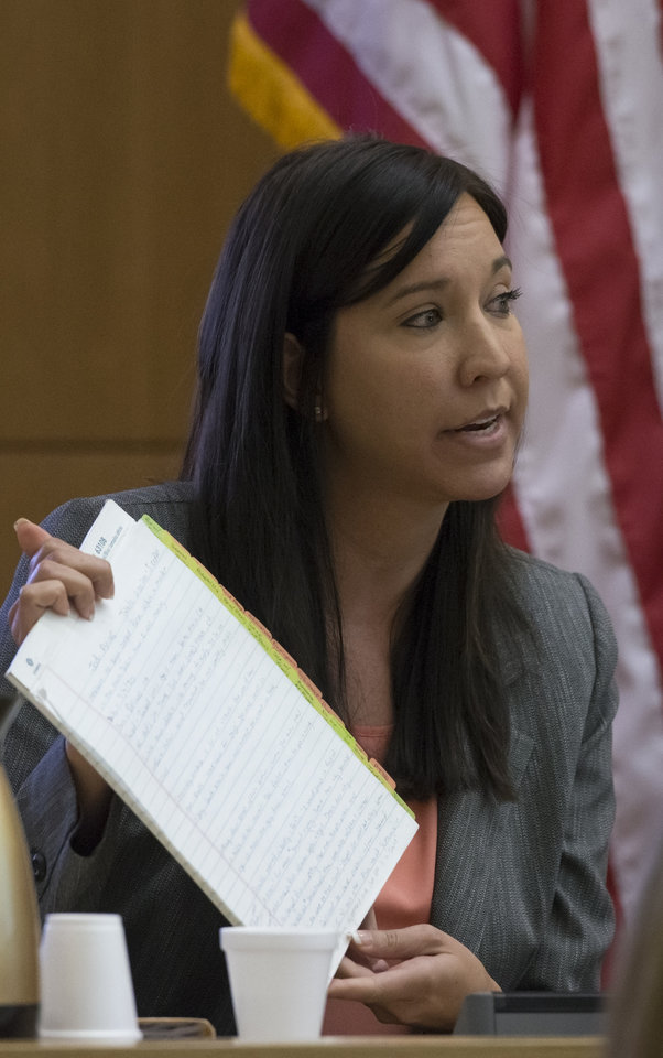 Dr. Janeen DeMarte an expert witness for the prosecution, is cross-examined by defense attorney Jennifer Wilmott during the Jodi Arias trial at Maricopa County Superior Court in Phoenix on Thursday, April 18, 2013. Arias faces a potential death sentence if convicted of first-degree murder in Travis Alexander's June 2008 killing at his suburban Phoenix home. (AP Photo/The Arizona Republic, Mark Henle, Pool)