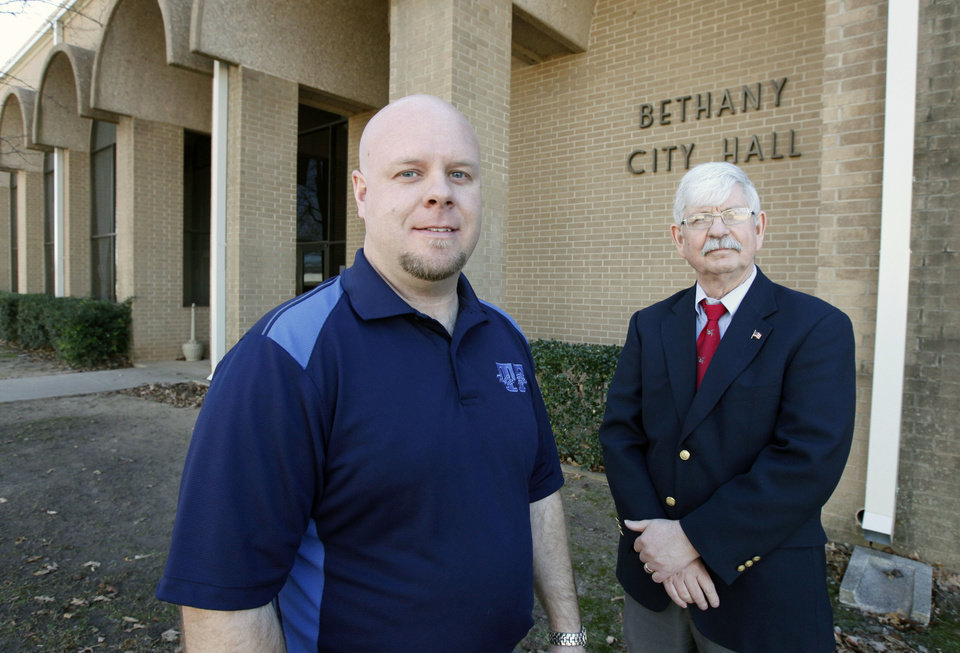Photo - Bethany Mayor Bryan Taylor, left, and City Manager John Shugart pose at city hall in Bethany on January 13. They are in a political battle with the Bethany Fire Department.  Photo by Paul Hellstern, The Oklahoman  PAUL HELLSTERN