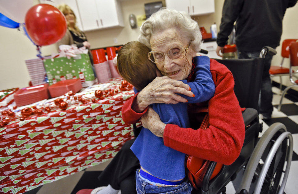 Ora E. Holland hugs her great grandson Wade Davis during her early birthday celebration at Heritage Assisted Living Center on Saturday, Dec. 22, 2012, in Oklahoma City, Okla. Holland will celebrate her 112th birthday on Dec. 24, 2012. Photo by Chris Landsberger, The Oklahoman