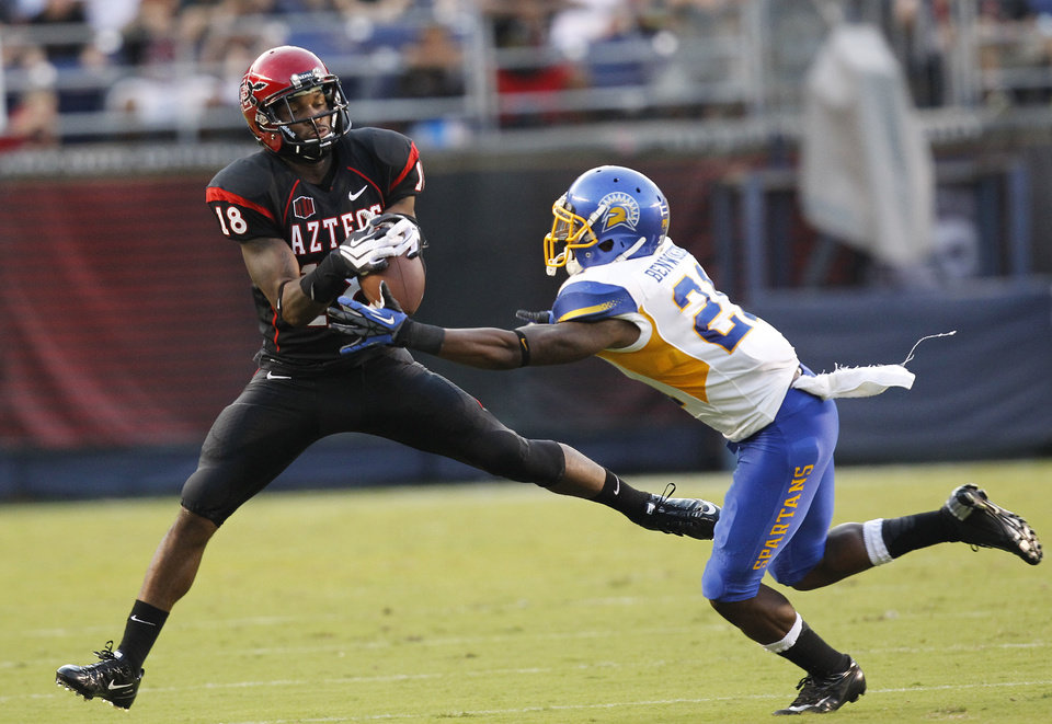 Photo -   San Diego State's Dominique Sandifer hauls in a pass during an NCAA college football game against San Jose State, Saturday , Sept. 22, 2012, in San Diego. (AP Photo/UT San Diego, Earnie Grafton) SAN DIEGO COUNTY OUT; NO SALES; COMMERCIAL INTERNET OUT; FOREIGN OUT