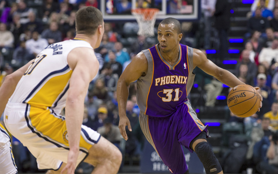 Photo - Phoenix Suns' Sebastian Telfair brings the ball up against Indiana Pacers' Tyler Hansbrough during the first half of an NBA basketball game in Indianapolis, Friday, Dec. 28, 2012. (AP Photo/Doug McSchooler)