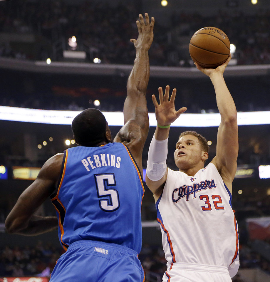 Photo - Los Angeles Clippers forward Blake Griffin (32) shoots as Oklahoma City Thunder center Kendrick Perkins (5) defends in the first half of an NBA basketball game in Los Angeles, Sunday, March 3, 2013. (AP Photo/Reed Saxon)