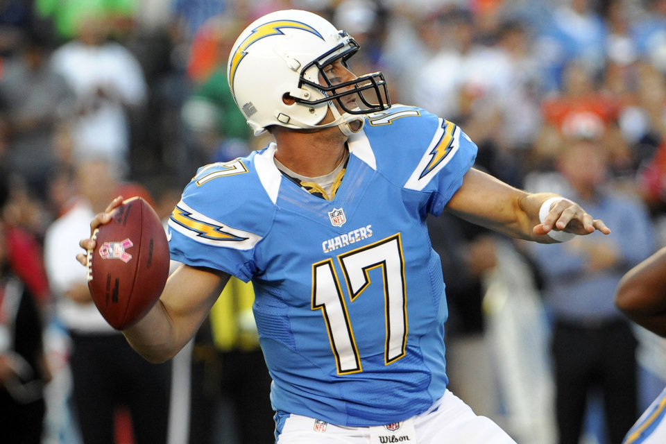 Photo -   San Diego Chargers quarterback Philip Rivers throws a pass against the Denver Broncos during the first half of an NFL football game, Monday, Oct. 15, 2012, in San Diego. (AP Photo/Denis Poroy)