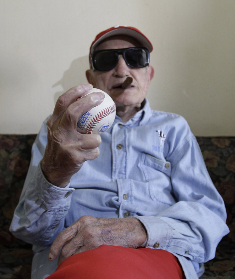 Cuban former pitcher Conrado Marrero, who once played with the Washington Senators, holds a ball as he poses for pictures during an interview in Havana, Cuba, Wednesday, April 25, 2012. Marrero, who last year became the oldest living former big leaguer, turned 101 on Wednesday. (AP Photo/Franklin Reyes)