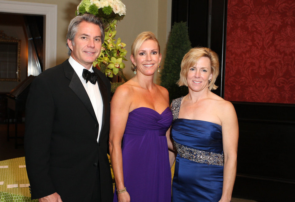 Photo -  Paul Brown and ball co-chairmen Mindy Brown and Tricia Everest.