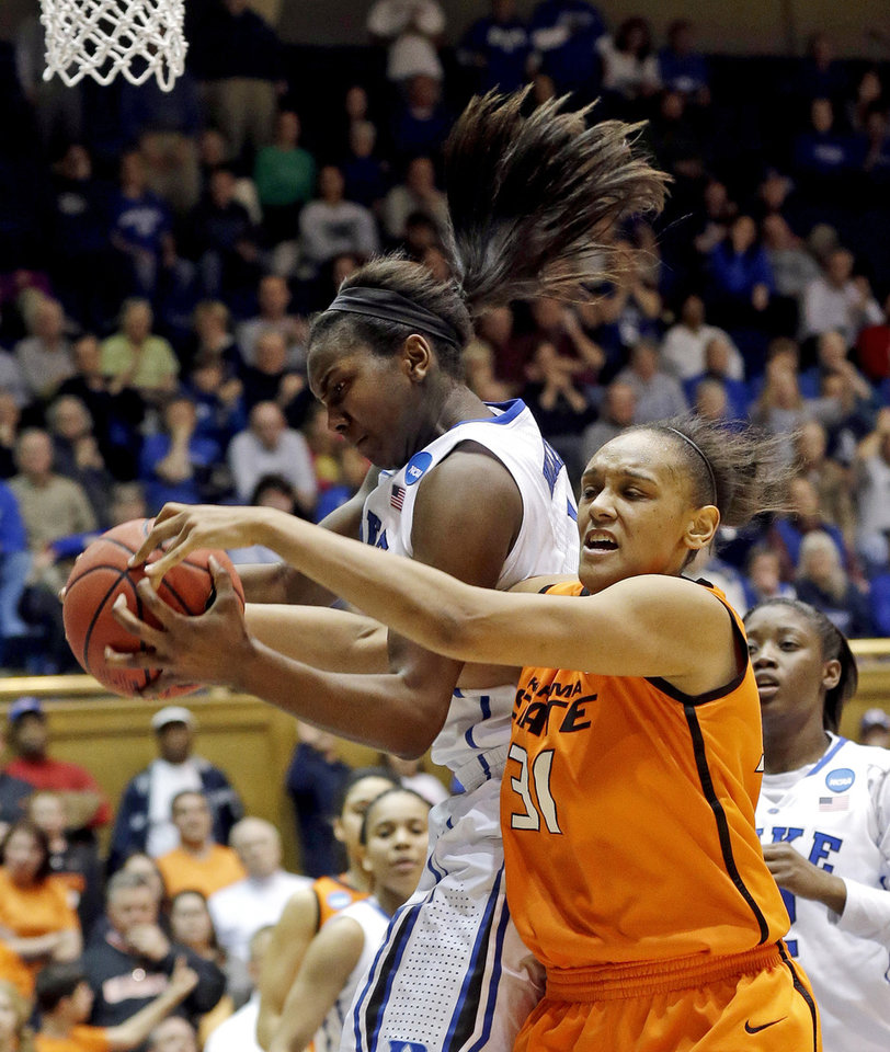 Duke\'s Elizabeth Williams (1) and Oklahoma State\'s Kendra Suttles (31) struggle for possession of the ball during the second half of a second-round game in the women\'s NCAA college basketball tournament in Durham, N.C., Tuesday, March 26, 2013. Duke won 68-59. (AP Photo/Gerry Broome)