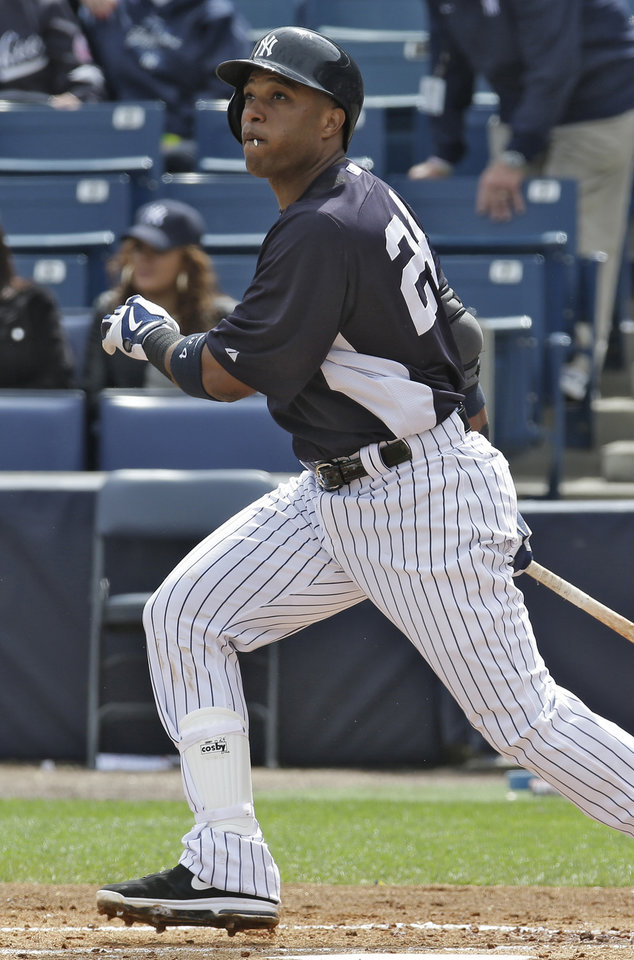 Photo - New York Yankees' Robinson Cano flies out to left off Philadelphia Phillies pitcher Roy Halladay during a spring training baseball game, Friday, March 1, 2013, in Tampa, Fla. (AP Photo/Chris O'Meara)