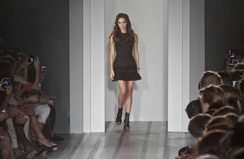 Photo -   Victoria Beckham appears after showing her Spring 2013 fashion collection on Sunday, Sept. 9, 2012 in New York. (AP Photo/Bebeto Matthews)