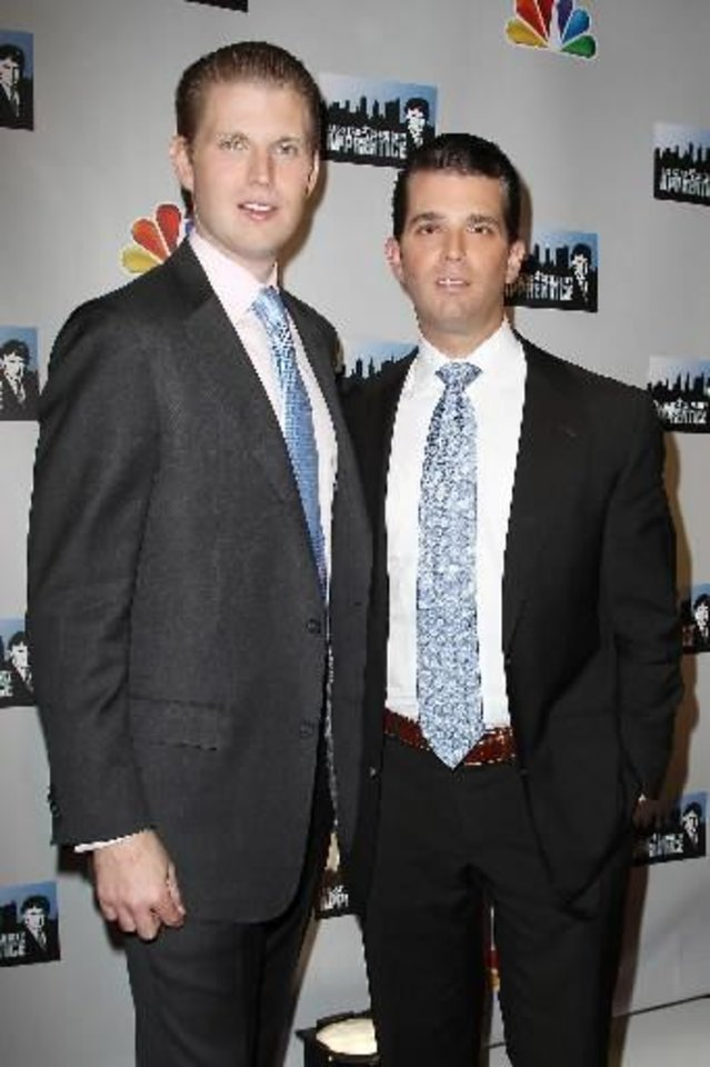 "This image released by Starpix shows Eric Trump, left, and Donald Trump Jr. posing at the cast announcement for the new ""All Star Celebrity Apprentice,"" Friday, Oct. 12, 2012 in New York. The show, which brings back contestants from previous seasons, will begin taping on Monday, Oct. 15, for the series premiering in March. (AP Photo/Starpix, Kristina Bumphrey)"