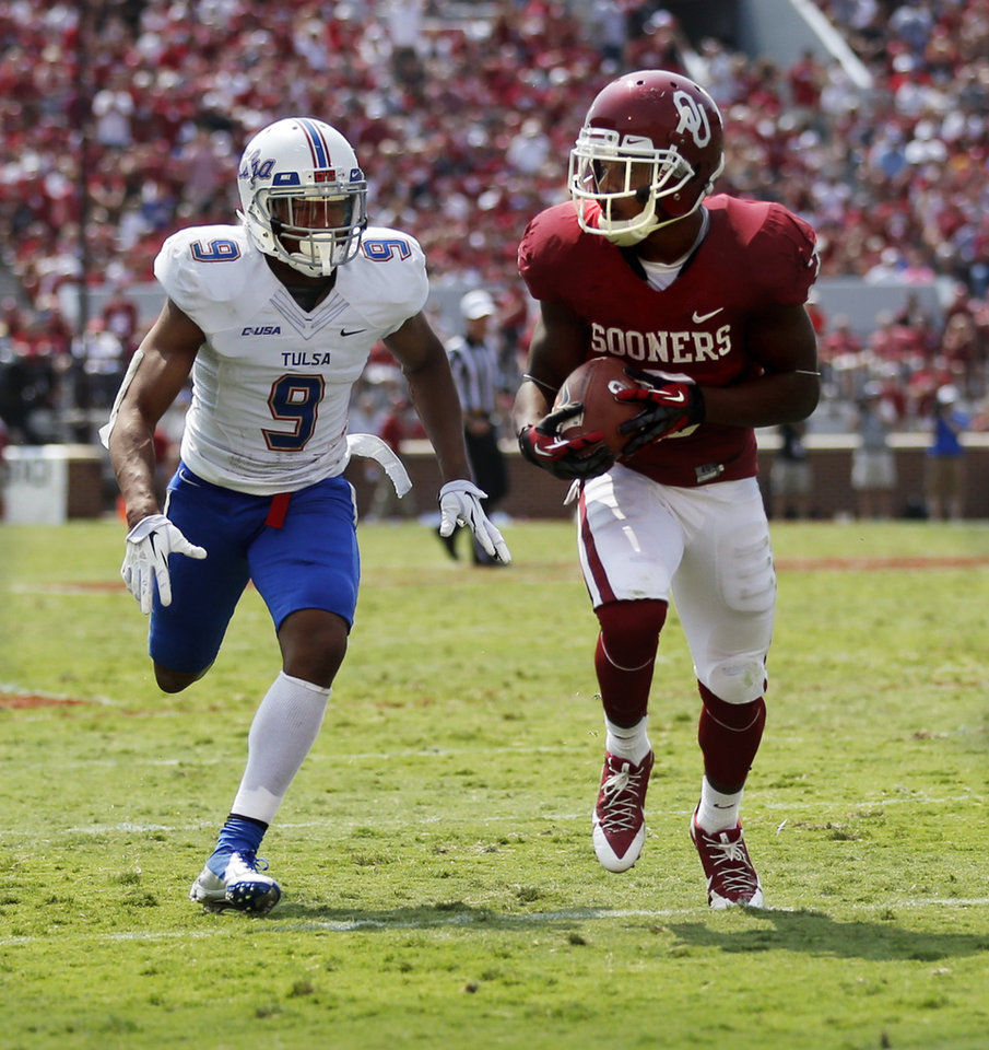 Oklahoma\'s Sterling Shepard (3) makes a touchdown reception during the second half of a college football game between the University of Oklahoma Sooners (OU) and the Tulsa Golden Hurricane (TU) at Gaylord Family-Oklahoma Memorial Stadium in Norman, Okla., on Saturday, Sept. 14, 2013. Photo by Steve Sisney, The Oklahoman