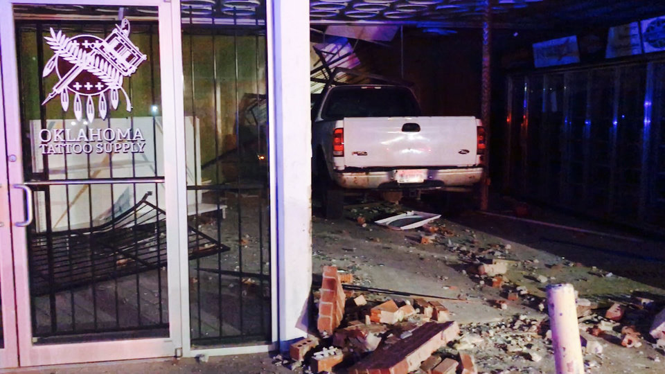 Photo -  A pickup crashed into a building near N Virginia Avenue and Linwood Boulevard Friday
