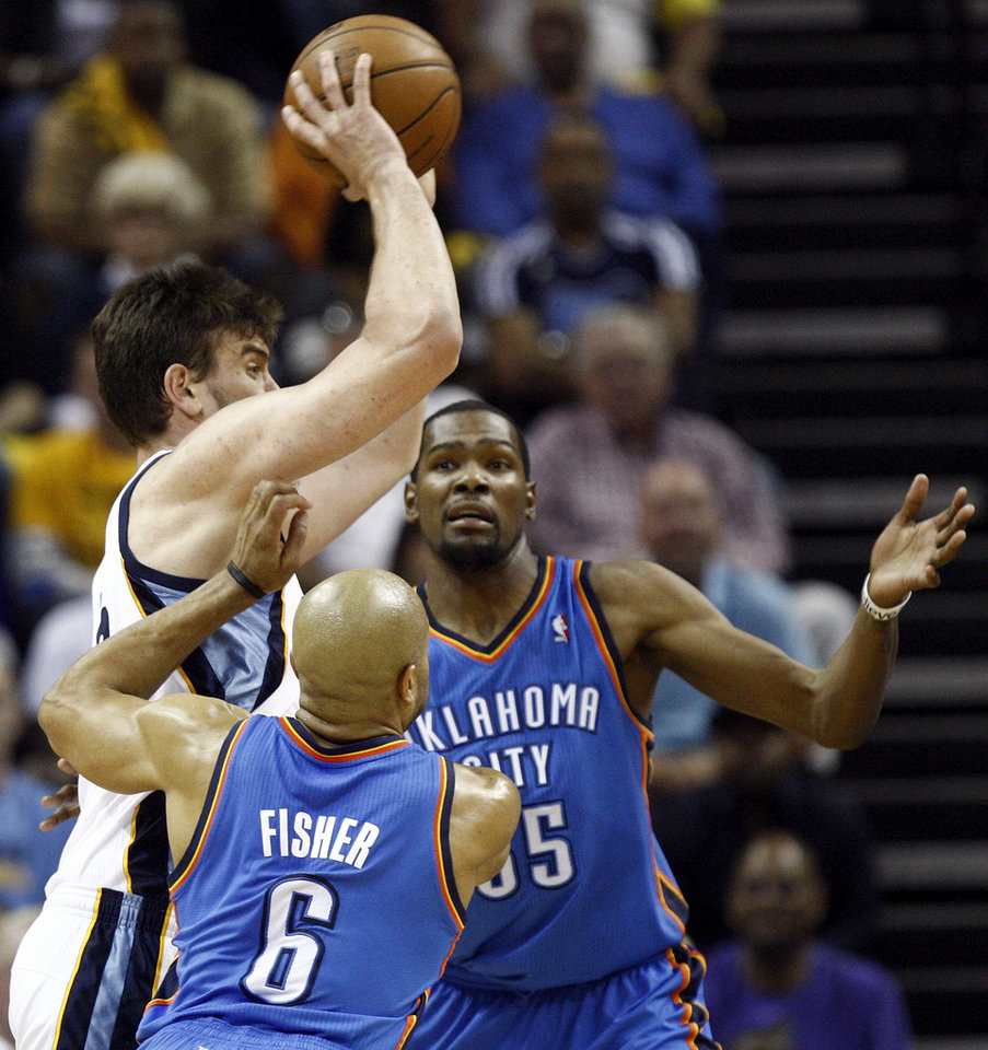 Photo - Memphis' Marc Gasol (33) passes away from the defense of Oklahoma City's Derek Fisher (6) and Kevin Durant (35) in the first half during Game 4 of the second-round NBA basketball playoff series between the Oklahoma City Thunder and the Memphis Grizzlies at FedExForum in Memphis, Tenn., Monday, May 13, 2013. Photo by Nate Billings, The Oklahoman