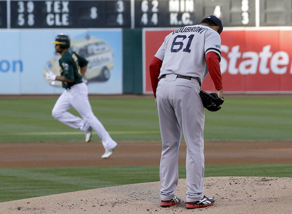 Photo -   Oakland Athletics' Coco Crisp (4) rounds the bases after hitting a solo home run off of Boston Red Sox starting pitcher Felix Doubront (61) in the first inning of a baseball game Saturday, Sept. 1, 2012 in Oakland, Calif. (AP Photo/Tony Avelar)