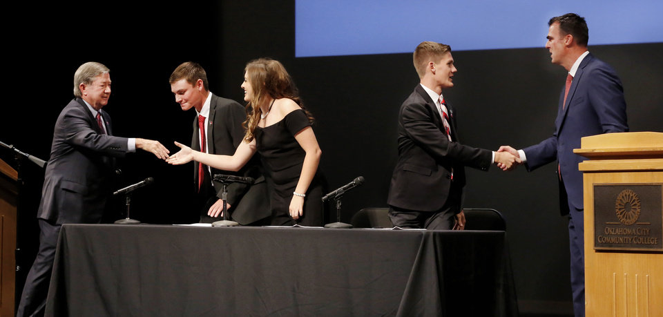 Photo -  The GOP and Democratic gubernatorial candidates shake hands and thank the three student moderators after a debate Thursday at Oklahoma City Community College. From left, are Democrat Drew Edmondson, Peyton Burns of Kingfisher High School, Emily Kennedy of Edmond North High School, Jayke Flaggart of Choctaw High School and Republican Kevin Stitt. [Photo by Jim Beckel, The Oklahoman]