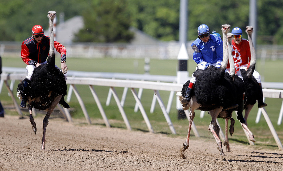 Ricky Ramirez and Pepe LePew lead the pack during Extreme Racing at Remington Park in Oklahoma City,  Sunday, April 22, 2012. Photo by SaraH Phipps, The Oklahoman.