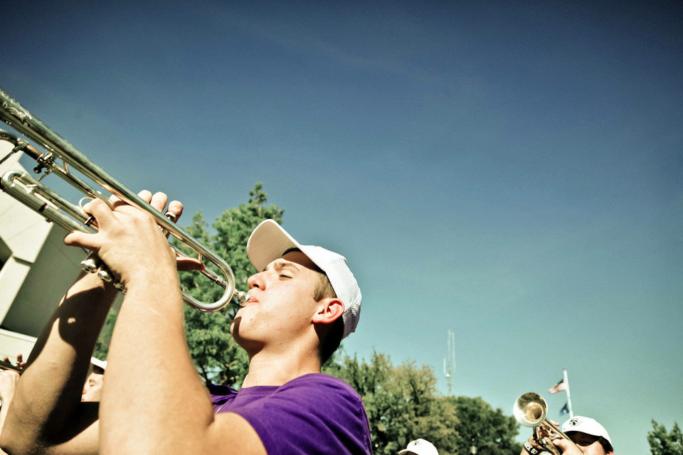 Photo - The band performs Wednesday during the Edmond Santa Fe High School homecoming parade.  Photo by Chris Landsberger, The Oklahoman