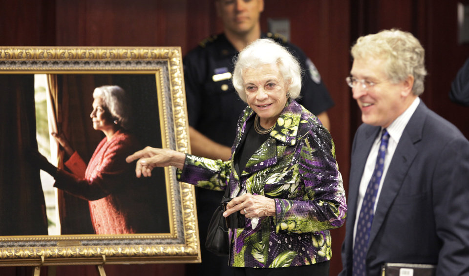 Photo - Retired Supreme Court Justice Sandra Day O'Connor comments on a portrait of herself to OCU President Robert Henry before she spoke to students, faculty and staff at OCU, Thursday, April 14, 2011. Photo by David McDaniel, The Oklahoman
