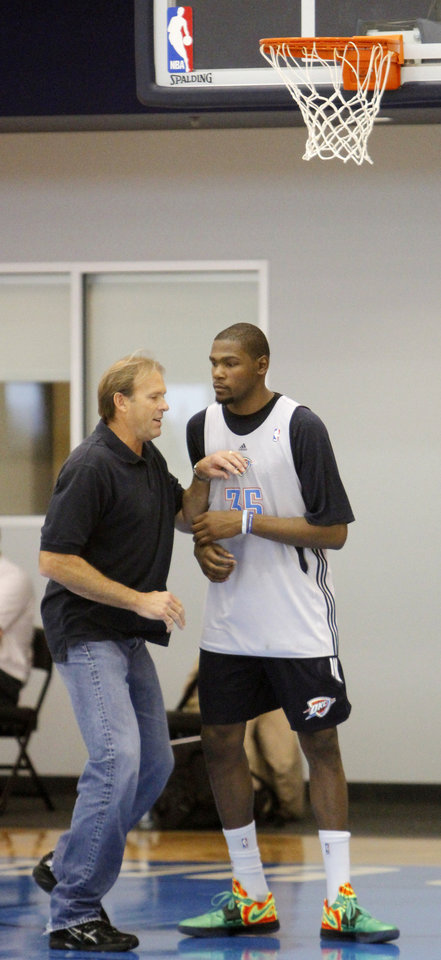 Photo - Kurt Rambis works one-on-one with the Thunder's Kevin Durant at the end of a practice session at the Thunder Practice Facility, Wednesday, Dec. 14, 2011. Photo by Doug Hoke, The Oklahoman
