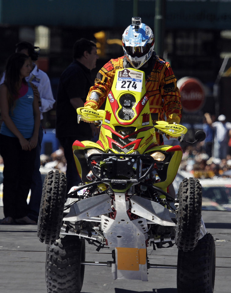 Photo - FILE - In this Saturday Jan. 1, 2011 file photo, Argentina's Nicolas Mangiantini, carrying a camera on his helmet, rides his Yamaha quad during the 2011 Argentina-Chile Dakar Rally symbolic start in Buenos Aires, Argentina. For adventure athletes, it's the new essential: a video of their exploits. Now only video action will do for a shoot-it-and-share-it generation of skiers and skydivers, snowboarders and bike riders. (AP Photo/Eduardo Di Baia, File)