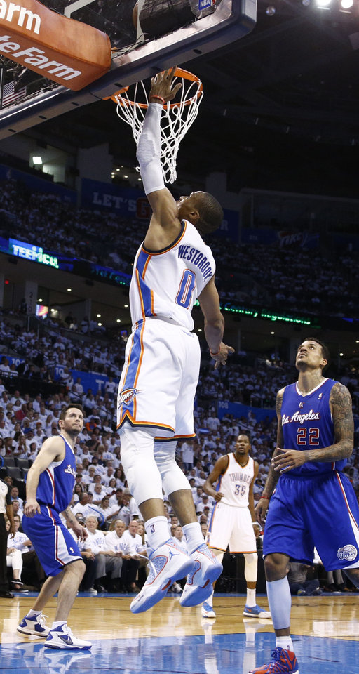 Photo - Russell Westbrook (0) gets a wide open layup during Game 5 of the Western Conference semifinals in the NBA playoffs between the Oklahoma City Thunder and the Los Angeles Clippers at Chesapeake Energy Arena in Oklahoma City, Tuesday, May 13, 2014. Photo by Sarah Phipps, The Oklahoman