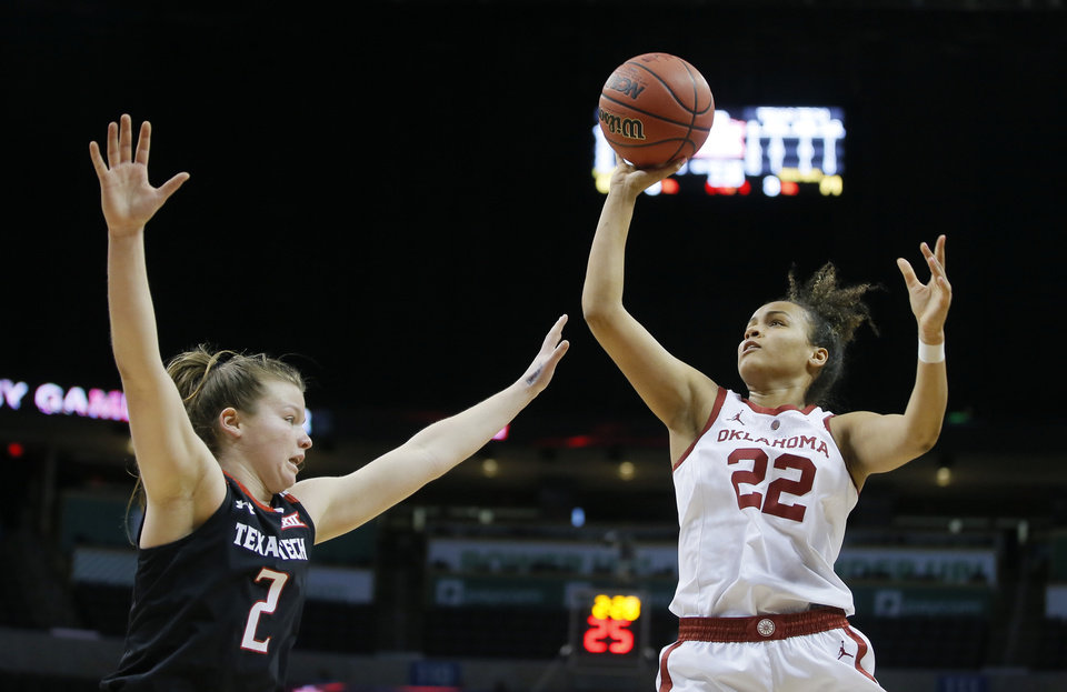 Photo - Oklahoma's Ana Llanusa (22) attempts a shot over Texas Tech's Sydney Goodson (2) during a game between the University of Oklahoma (OU) and Texas Tech in the first round of the women's Big 12 basketball tournament at Chesapeake Energy Arena in  Oklahoma City, Friday, March 8, 2019. Texas Tech won 104-84. Photo by Bryan Terry, The Oklahoman