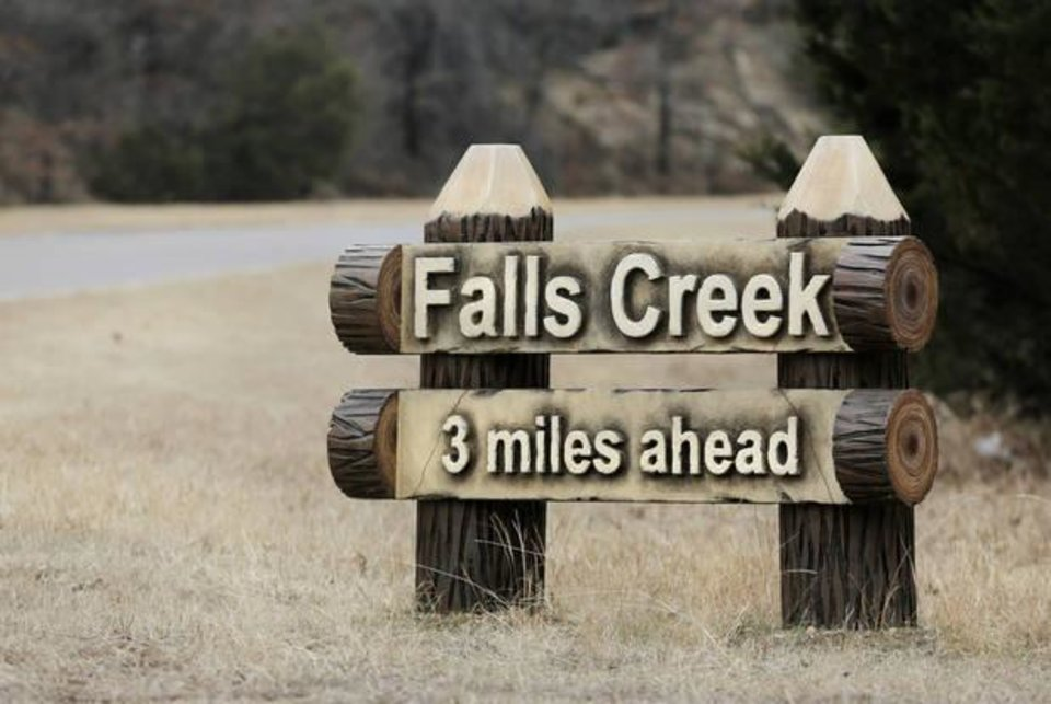 Photo -  A sign directs visitors to the entrance of Falls Creek Baptist Conference Center. [Photo by Jim Beckel, The Oklahoman]